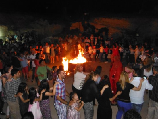 Yasar Baba Resturaunt & Turkish Nights: The bonfire outside with geusts dancing congo line around it