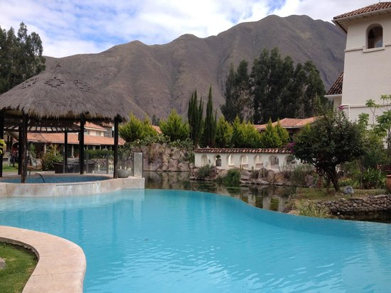 Aranwa Sacred Valley Hotel & Wellness: The main pool and the jacuzzi. The pool is too cold but the jacuzzi is still warm enough in July