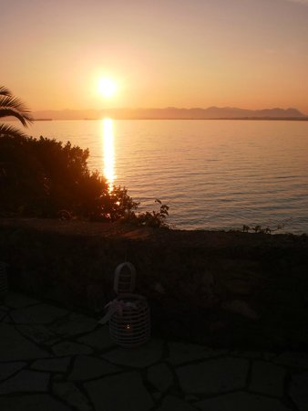 Messinian Bay Hotel: sunset from outside dining space