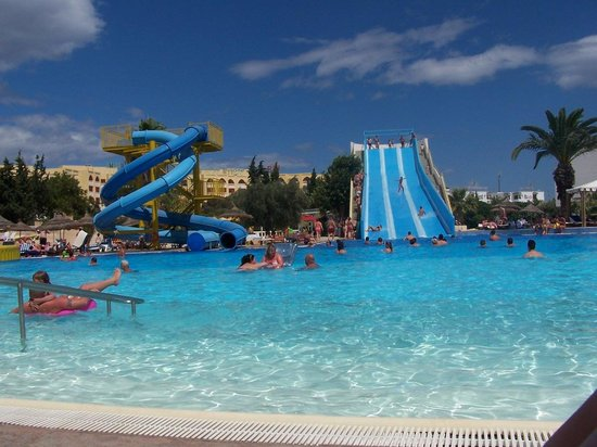 Soviva Resort : A section of the pool with the slides from the sunbed.