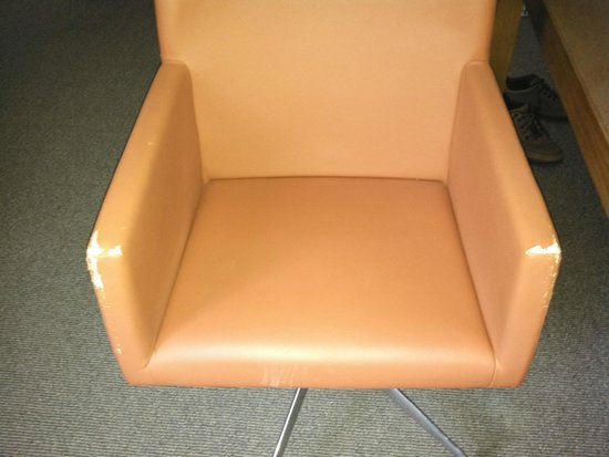 Andaz 5th Avenue: Chair with torn upholstery