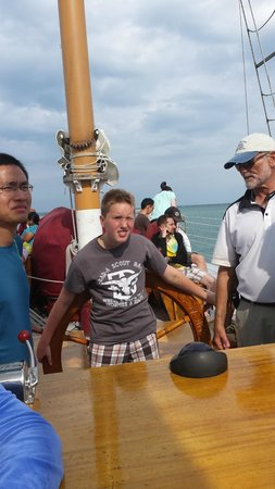 Tall Ship Windy: Windy's Captain instructs a young visitor on steering a tall ship