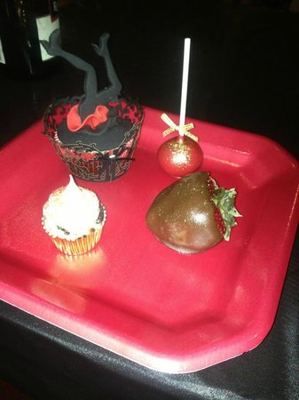 Sampler of dessert table items from burlesque themed birthday party