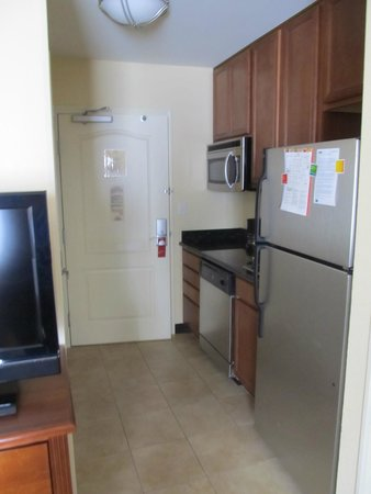 TownePlace Suites Odessa: Kitchen area; full sized refrigerator, microwave & dishwasher