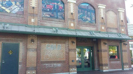 Portillo's: The Outside has Painted Murals and Old Brick Style Building.