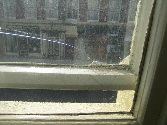 The Eaton Hotel: Broken, unwashed window