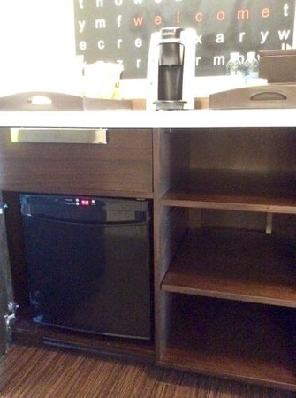 The Alexander: Fridge underneath breakfast bar