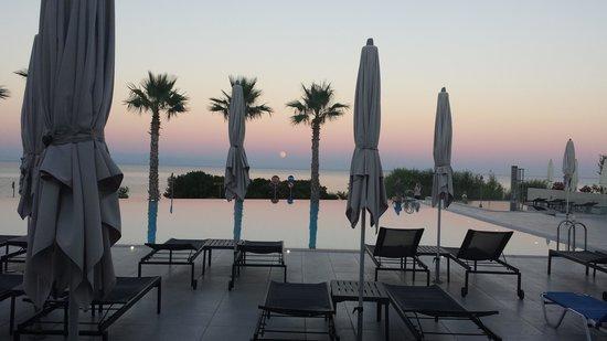 TUI Sensimar Tesoroblu Hotel & Spa: pool area on an evening
