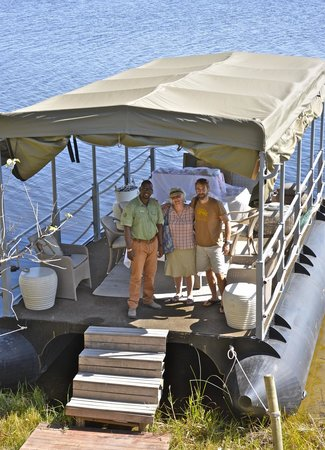 Wilderness Safaris DumaTau Camp: Boat for private lunch, guide (Tank) on left