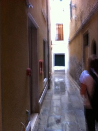 Corte Barozzi Venice Suites: You will end up in a narrow street. You will be at the top. Head towards where the picture was t