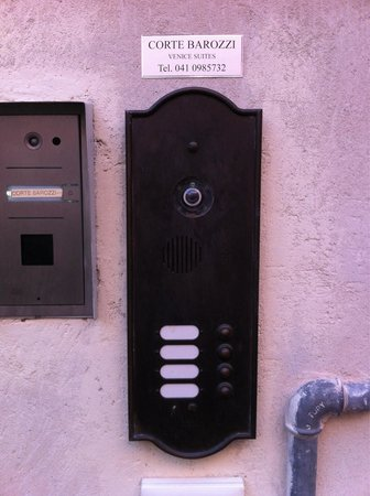Corte Barozzi Venice Suites: Close inspection of the intercom shows the little plate. Corte Barozzi. You've arrived! Press th
