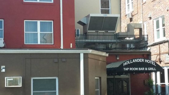 Hollander Hotel: Note the small a/c unit for my room & the big noisy unit next to it.
