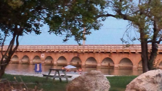 Sunshine Key RV Resort & Marina: Old fishing bridge by the swim area