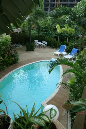 Oasis Villa: View of pool from ground
