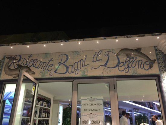 Ristorante Bagni Delfino: Restaurant main door. When we said it was our honeymoon, they gave us a table! Lovely staff