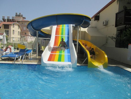 Sun City Apartments: Water Slides! Never too old for them!