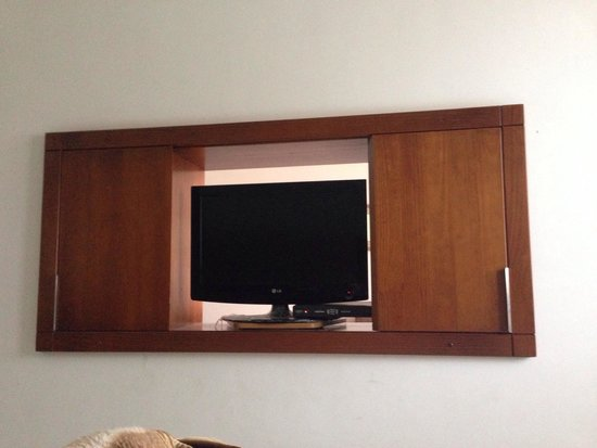 Copacabana Suites by Atlantica: A tv used both in the living room and bedroom.