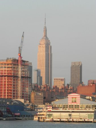 Spirit of New York : The setting sun reflecting off of the Empire State Building