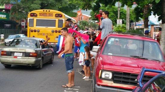 Posada Jaco: Street scene of the happy Tico soccer fans.