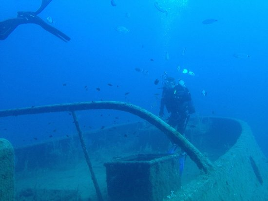 Dawn Diving: on the stern of the Rozi at 30 mtrs