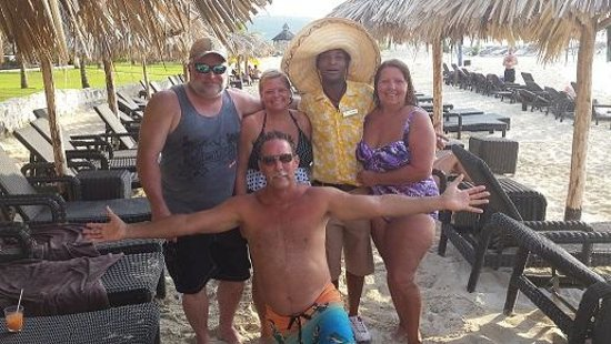 Secrets Wild Orchid Montego Bay : Our group with our beach server Leonard Anderson