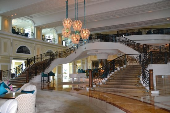 Waldorf Astoria Ras Al Khaimah: stunning sweeping dual staircase one going up and the other coming down
