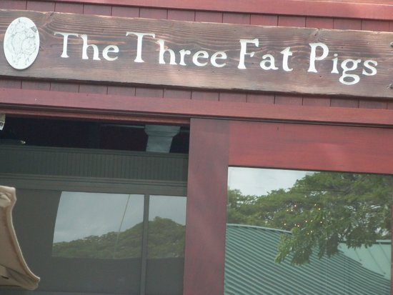 Three Fat Pigs: sign