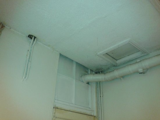 The Continental Hotel: holes in ceiling and pipes/vents