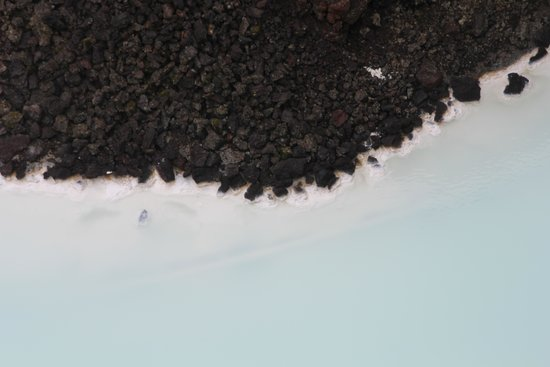 Blue Lagoon Iceland: Dark lava, white minerals, blue lagoon