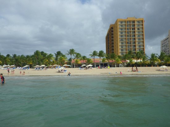 Courtyard Isla Verde Beach Resort: Hotel from water