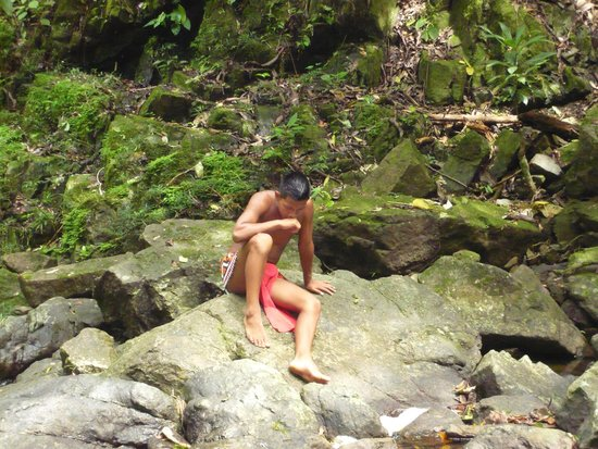 Emberá Village Tours & More: Our guide waiting for us at the water fall.