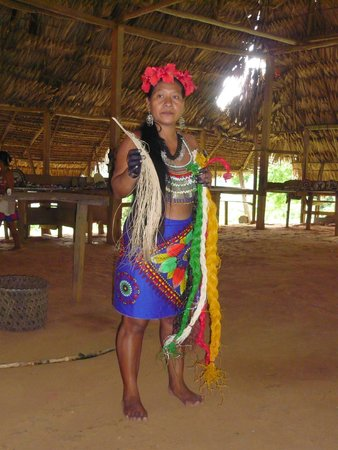 Embera Village Tours & More: The lady was explaining to us how some of crafts are made.