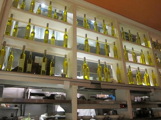 Fig & Olive Fifth Avenue : Olive oil bottles as decor on the ground floor - the second floor boasts wine