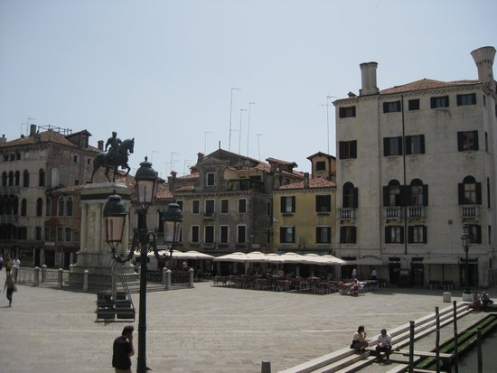 Snack Al Cavallo: View of piazza and restaurant from canal bridge