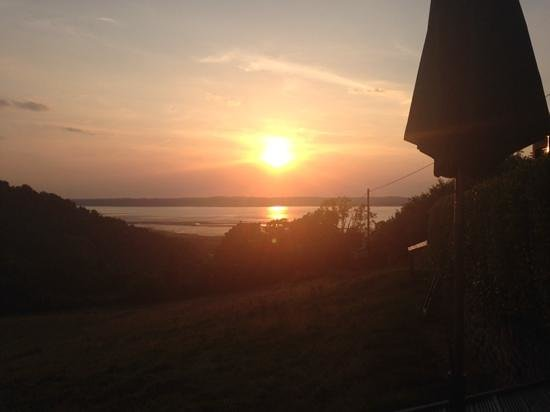 Rhiwiau Guest House: the sun set from the decking
