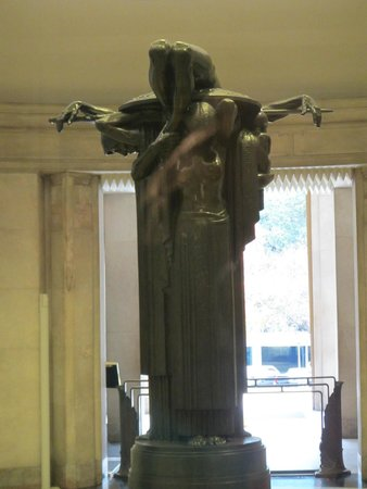 Anzac War Memorial: Showing that the sculpture of the dead soldier is held up by three women