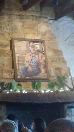 Hondo's on Main: Inside Hondo's restaurant with a photo of Hondo Crouch.