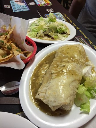Lucy's Taqueria: One grilled steak taco and the fish burrito wet. So ONO