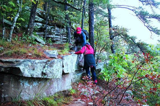 Hawksbill Crag: Climbing up the rocks at the edge of a cliff.