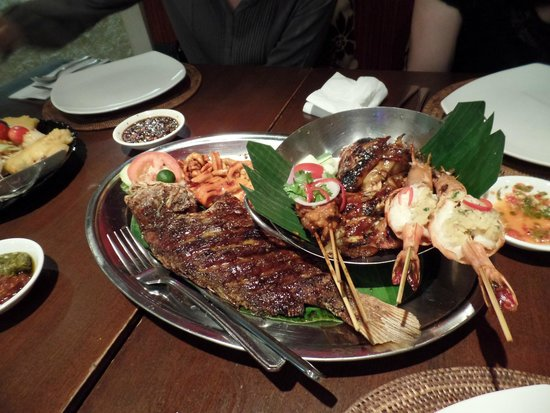 Bayang Balinese Cuisine: Complete grill platter: grilled fish, squid, chicken, and satay.