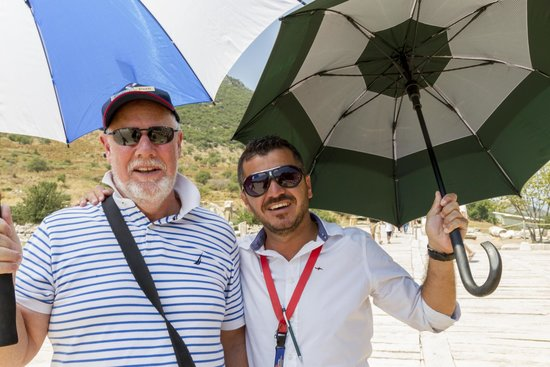 Kusadasi Private Ephesus Tours: Hakan on the right - it is wise to take an umbrella for protection from the sun