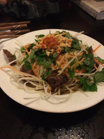 Quan An Ngon: Green papaya salad with sparrows.