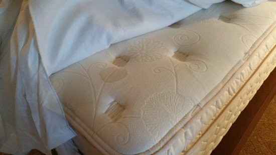 Inn of the Mountain Gods Resort & Casino: Disgusting, 6 inch diameter bodily fluids stain on one of the queen sized mattress in suite 393.