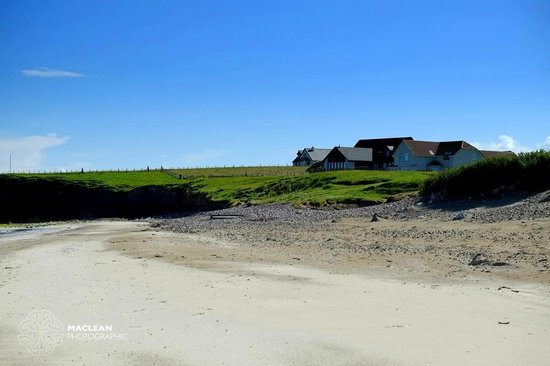 Looking back at Broad Bay House from the beach