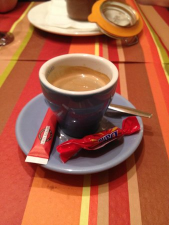 Au Petit Suisse: Coffee with dessert showing in background