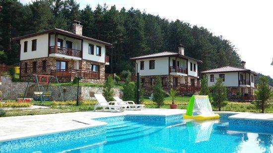 Eco Village Ruminika: Houses & pool