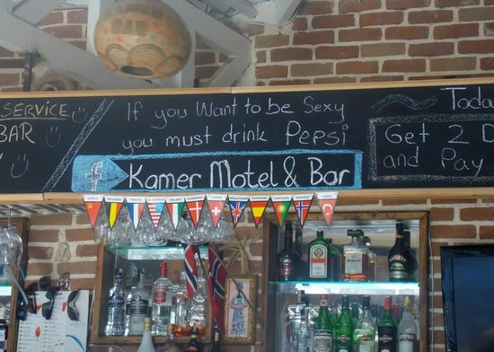 Kamer Motel: Humorous signs in the bar area!