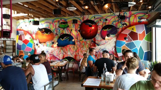 Puesto Mexican Street Food: View inside one of 2 rooms, bar on left