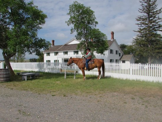 Grant-Kohrs Ranch - National Historic Site: Cowgirl and house