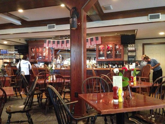 The Yankee Rebel Tavern: Dining area with bar in back